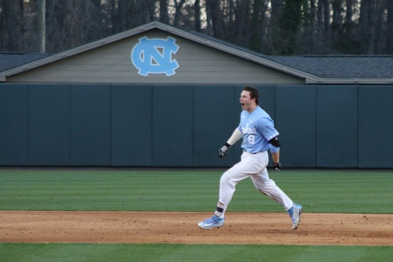 Freshman Kyle Datres (8) celebrates after hitting a walk off RBI to secure the Carolina men's baseball team's 2-1 victory over Oklahoma State University.