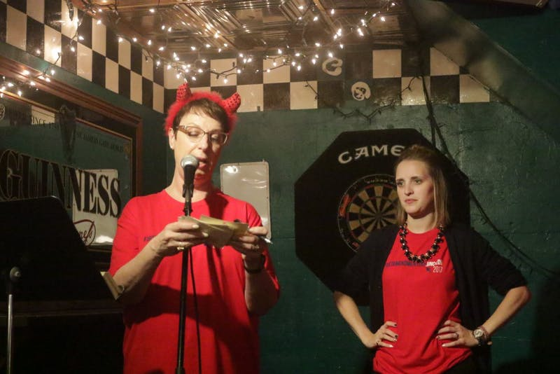 Rhonda Gibson, UNC journalism professor, presents First Amendment trivia with Kyla Garrett Wagner at Linda's tuesday night.