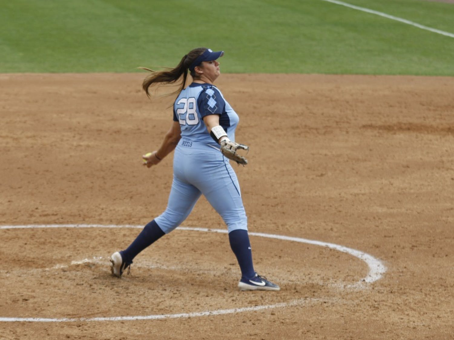 Junior pitcher and first baseman Brittany Pickett (28) pitches during UNC's double header against the University of Virginia. The Tar Heels won both games 8-0 at the G. Anderson Softball Stadium on Sunday, Apr. 7, 2019.
