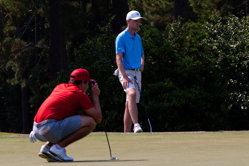 Senior Ryan Gerard waits for his opponent to putt before he makes his winning shot at the Rod Myers Invitational on Sept. 12, 2021.