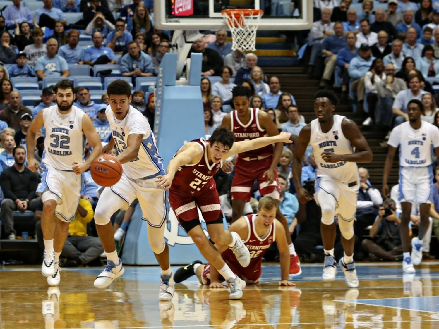 UNC guard Cameron Jonson (13) breaks past Stanford players in the Dean Smith Center on Monday, Nov. 12, 2018. UNC won 90-72.