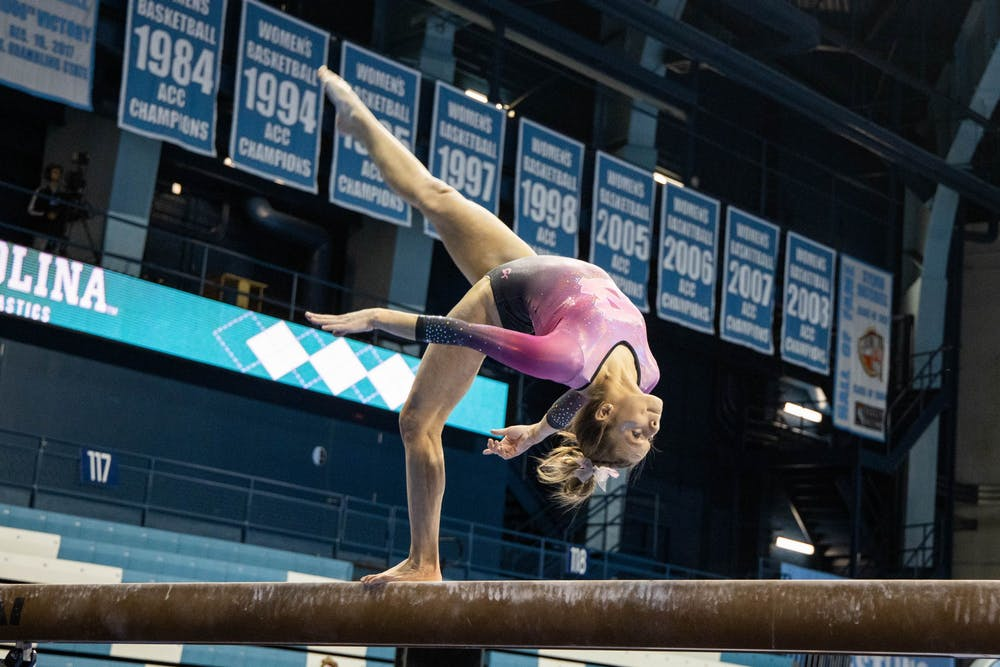 <p>First-year Elizabeth Culton performs her beam routine during the gymnastics meet against the University of New Hampshire in Carmichael Arena on Monday, Feb. 17, 2020. The Tar Heels placed first against the Wildcats.</p>
