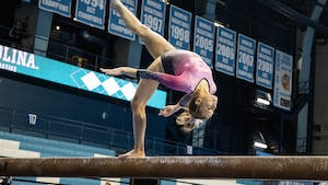 First-year Elizabeth Culton performs her beam routine during the gymnastics meet against the University of New Hampshire in Carmichael Arena on Monday, Feb. 17, 2020. The Tar Heels placed first against the Wildcats.
