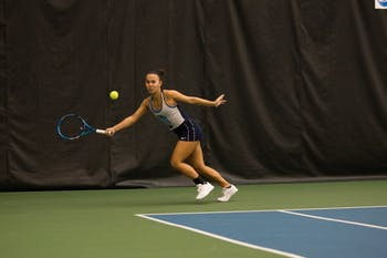 First-year Kacie Harvey returns the ball in a singles match against NC State at the 2019 Kitty Harrison Invitational hosted by UNC at the Cone-Kenfield Tennis Center on Sunday, Nov. 3, 2019. 8 teams competed in the multi-day tournament, and UNC
