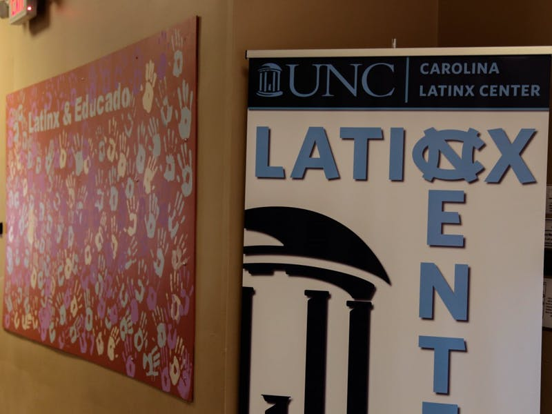 A mural sits between offices and workrooms at the new Carolina Latinx Center, located inside Abernethy Hall.