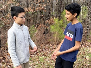 (From left) Gulinky Lu and Arul Nagarajan are two of the three eighth-graders who will perform their poetry on Jan. 19, 2020 for the Emerging Diverse Voices in Orange County performance series. Photo courtesy of Kim Lane.
