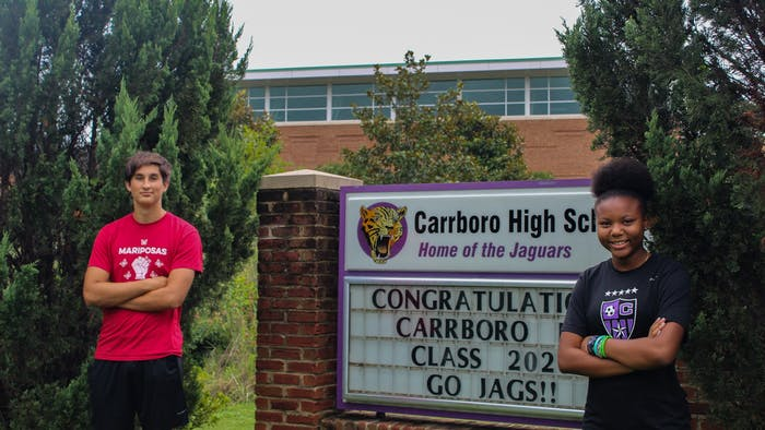 """From right: Carrboro High School seniors Navia Mosley and Phoenix Tudryn are two of the students who recently launched The Black and Brown Student Coalition podcast about living as a student of color right now during the pandemic. """"We wanted to give a voice to the black and brown kids in our school to be able to speak to teachers directly as to what they can do better to support them,"""" Tudryn said."""