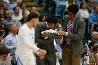 UNC basketball players on the bench coddle a towel as they pass it off kissing it and patting its head while pretending it is a baby. UNC men's basketball beat NC state with the most points scored on the Wolfpack since 2003. UNC won 113-96 at the Smith Center on Tuesday, Feb. 5, 2019.