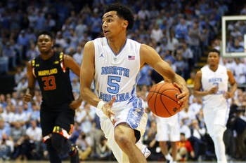 Senior guard Marcus Paige (5) drives the ball towards the basket. This was Paige's first game back after suffering a fracture to his non-shooting hand.