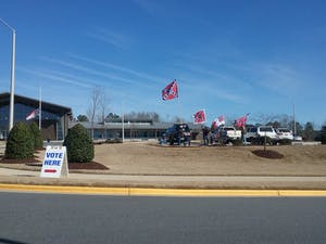Several pro-Confederate demonstrators flew flags from their trucks in the parking lot of the Chatham County Agriculture & Conference Center on Feb. 15, 2020, which hosted both an academic discussion of Civil War symbolism and an early voting polling place. Photo courtesy of Lindsay Ayling.