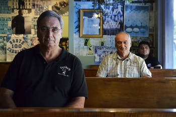 Breadmen's owners Roy Piscatello and Bill Piscatello sit with Omar Castro, who will take over as the new manager of the restaurant.