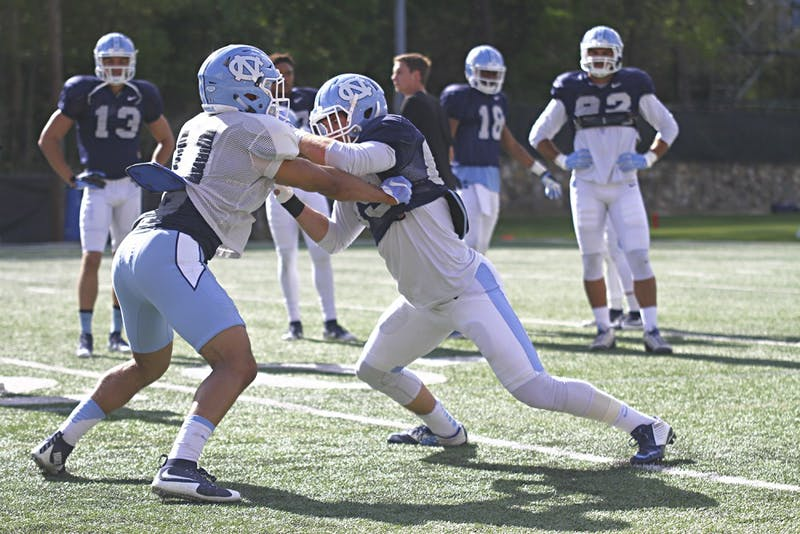 First year Myles Wolfolk and face off during spring practice Thursday afternoon.