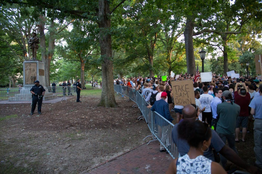 Students remain at Silent Sam statue following protests, arrests