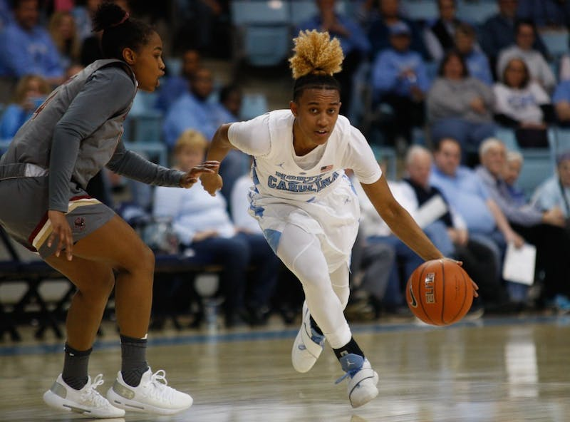 UNC redshirt senior guard Paris Kea (22) dribbles the ball up the court during a game against Boston College on Thursday, Feb. 21, 2019 in Carmichael Arena.