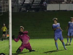 UNC Midfielder Jack Skahan (8) misses a header against Winthrop on Tuesday Oct. 16 at WakeMed Soccer Park. He had a hat trick during the game.