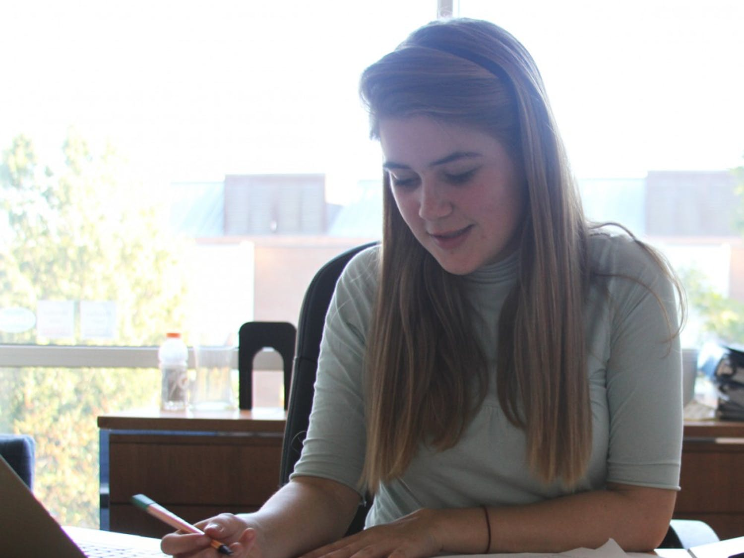 Student Body President Mary Cooper works in her office in the student union.  She is struggling to represent student opinion on tuition increases while also doing what she thinks is best for the university.