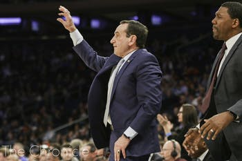 Coach K yells commands during a game. Photo by Helen Wood, courtesy of the Chronicle.