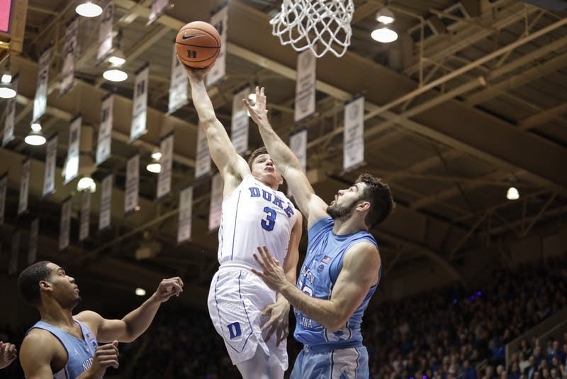 Duke guard Grayson Allen (3) tries to dunk on North Carolina forward Luke Maye (32) in Cameron Indoor Stadium on March 3.