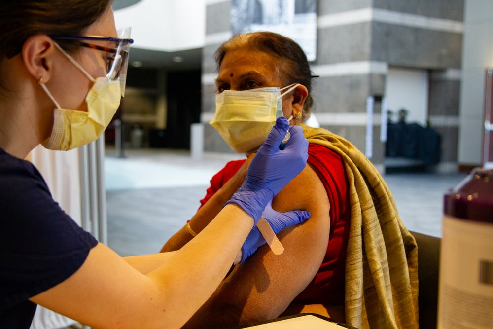 <p>Cary resident Neelima Singh receives the first dose of the Moderna COVID-19 vaccine on Thursday, Jan. 21, 2021 in the Friday Center.</p>
