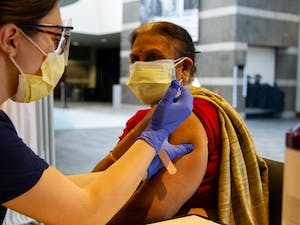 Cary resident Neelima Singh receives the first dose of the Moderna COVID-19 vaccine on Thursday, Jan. 21, 2021 in the Friday Center.