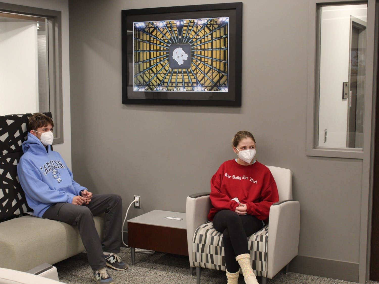 Tanner Clary and Audrey Frye sit in a waiting room at the Campus Health building on April 24, 2021.