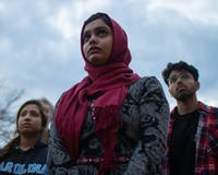 (From left) Senior psychology major and Arabic minor Sana Mohiuddin, junior public policy major and medical anthropology minor Nazneen Khan and first-year political science major Wali Khan listen to speakers during a vigil honoring the Christchurch shooting victims in front of the Student Union on Thursday, March 21, 2019.