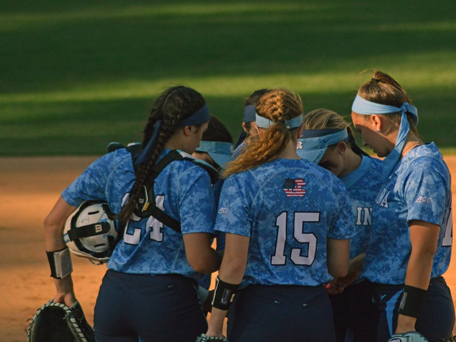 The UNC softball team huddled together to discuss their plays during their game against Louisville Saturday.