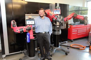 Lloyd Williams stands in front of a robot. Williams is a computer science professor at Shaw University working to diversify his field. Photo courtesy of Williams.