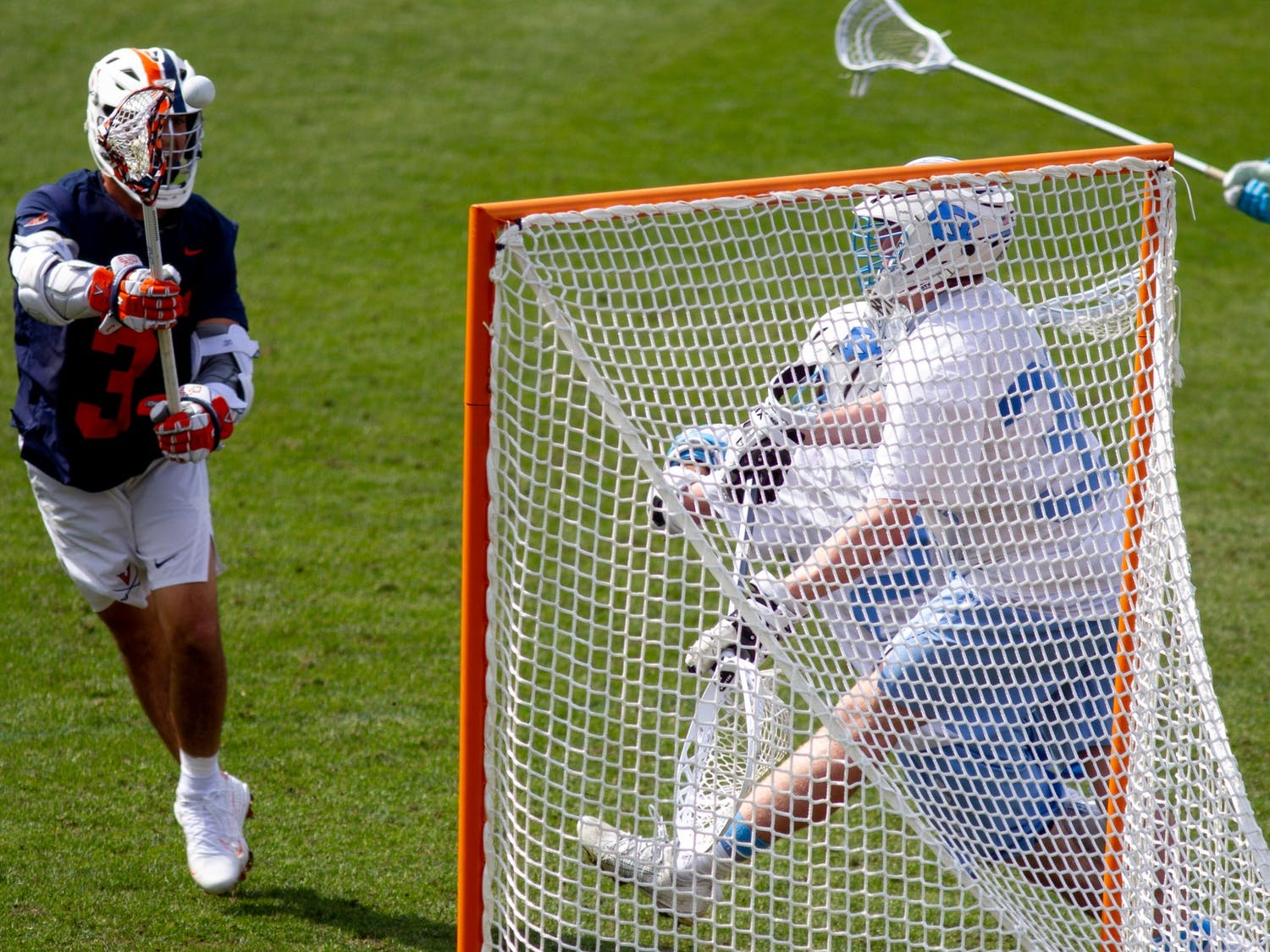 UVA senior attackman Ian Lavaino (3) attempts a shot during an 18-16 win over UNC at Dorrance Field on April 10, 2021.