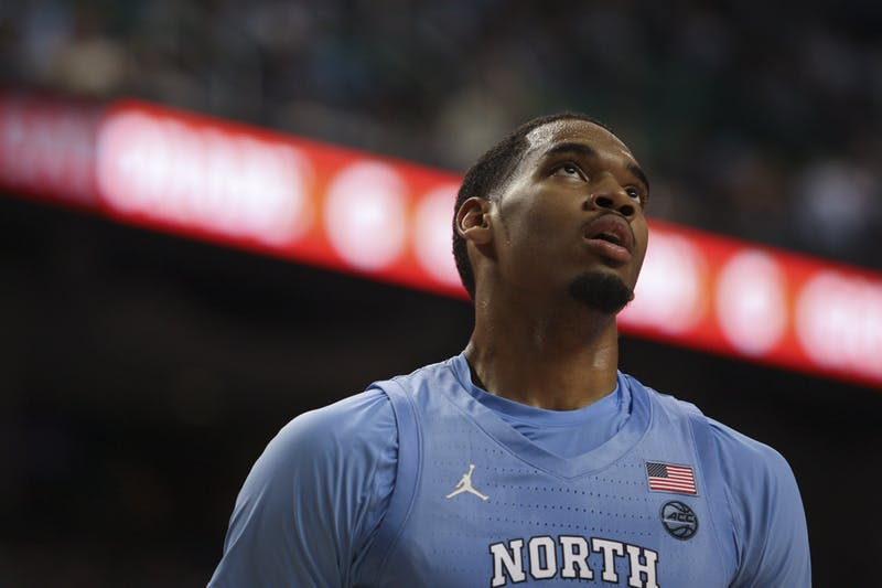 Junior forward Garrison Brooks (15) looks upon the crowd during the first round game of the ACC tournament against Virginia Tech in the Greensboro Coliseum Complex on Tuesday, March 10, 2020. UNC beat Virginia Tech 78-56.