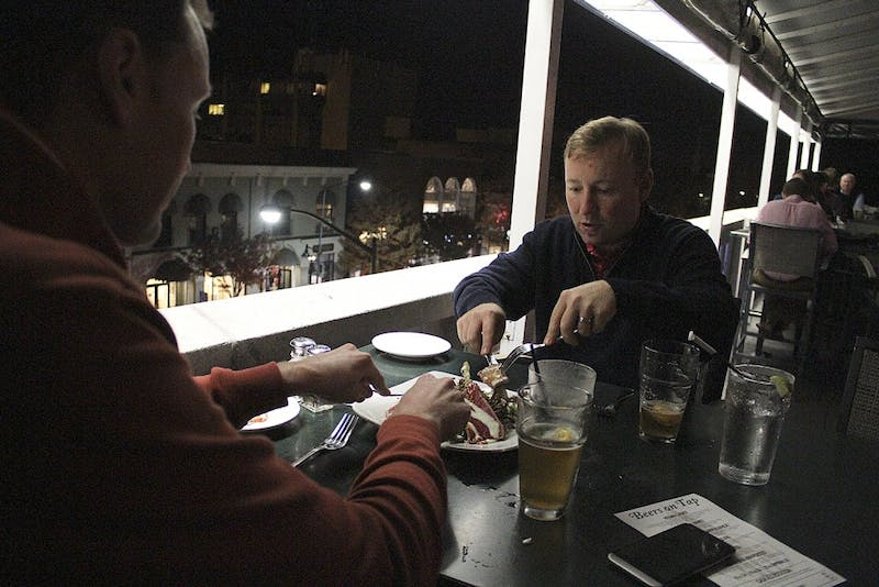 Michael Thornburg is a Senior and majoring Political Science.  He started rapping after he graduated high school; he often finds motivation in emotional struggle. Dennis Farrell and David Deterding (right) enjoy a meal at Top of The Hill on Franklin Street during the Inter-Faith Council's annual Restaurant Sharing Ten Percent event Tuesday.