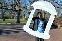 Bradley Opere poses with his Old Well cut out Friday afternoon. Opere held an event to take photographs with people who are supporting his campaign to run for Student Body President.