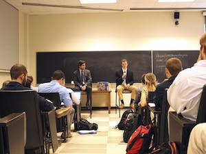Wilson Sink (left) and John Taylor participate in the Student Body President debate hosted by Student Congress Tuesday evening. Bradley Opere was present, however could not participate.