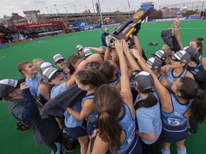 The North Carolina field hockey team poses with National Championship trophy following a 2-0 win over Maryland at Trager Stadium on Nov. 18 at Trager Stadium in Louisville, Ky. Photo courtesy of Jeffrey A. Camarati.
