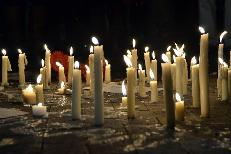File photo/Candles burning at a vigil.