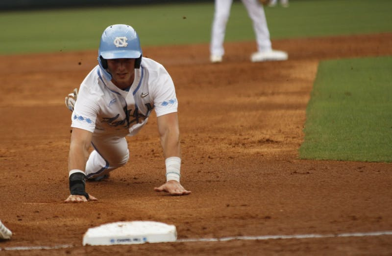 UNC baseball junior and 1B, Michael Busch, prepares slides into third base during the Tar Heel's first game in the regional championship versus UNCW on Friday May 31, 2019. UNC won 7-6.