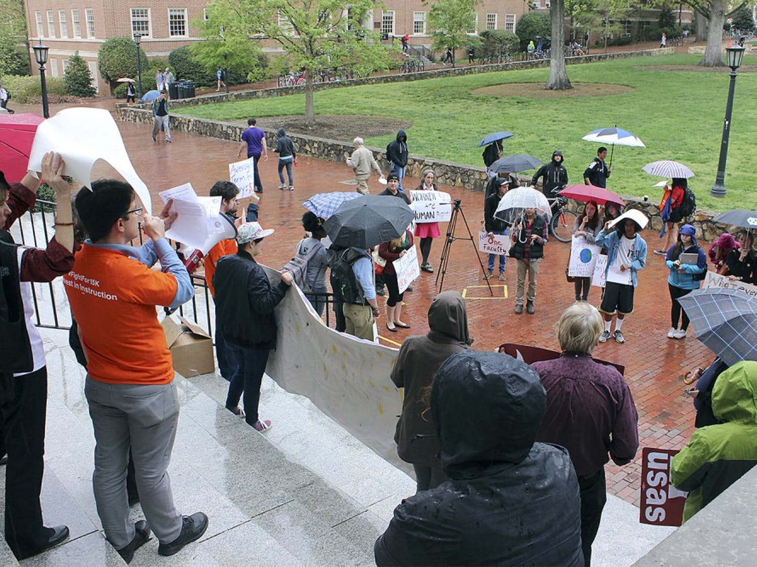 UNC students and faculty gathered in front of Wilson Library Wednesday afternoon to support higher wages for faculty and staff.