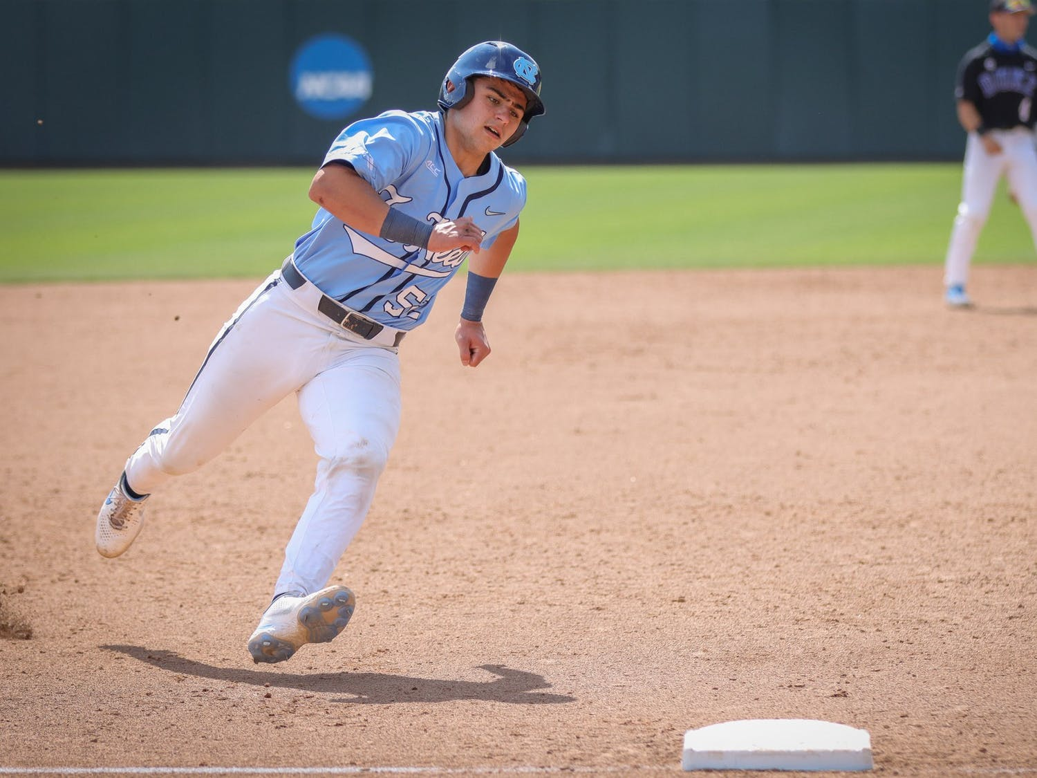 UNC freshman catcher Tomas Frick (52) rounds third base during the Tar Heels' 11-5 win against Duke on Sunday, April 11, 2021 in Boshamer Stadium.