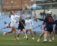 Sophomore attacker Jamie Ortega (3) and first-year attacker Tayler Warehime (22) play during UNC Women's lacrosse first ACC game. UNC defeated UVA 13-12 at Fetzer Field in Chapel Hill on Saturday, March 9, 2019.