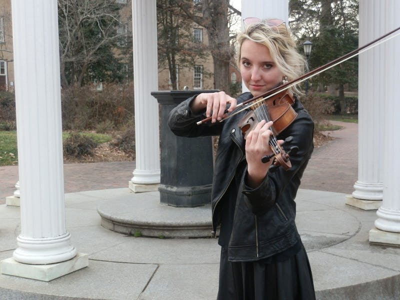 Waverly Leonard plays the fiddle in the Carolina Bluegrass Band.