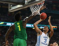 North Carolina forward Kennedy Meeks (3) shoots over Oregon forward Jordan Bell (1) in the teams' Final Four matchup on Saturday in Phoenix.