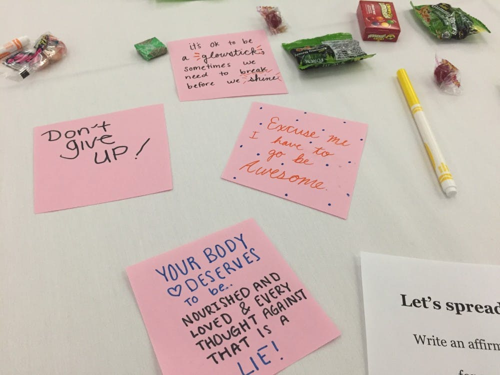 Some sticky notes with encouraging thoughts left on one of the tables at EMU's Self-Care Fair.