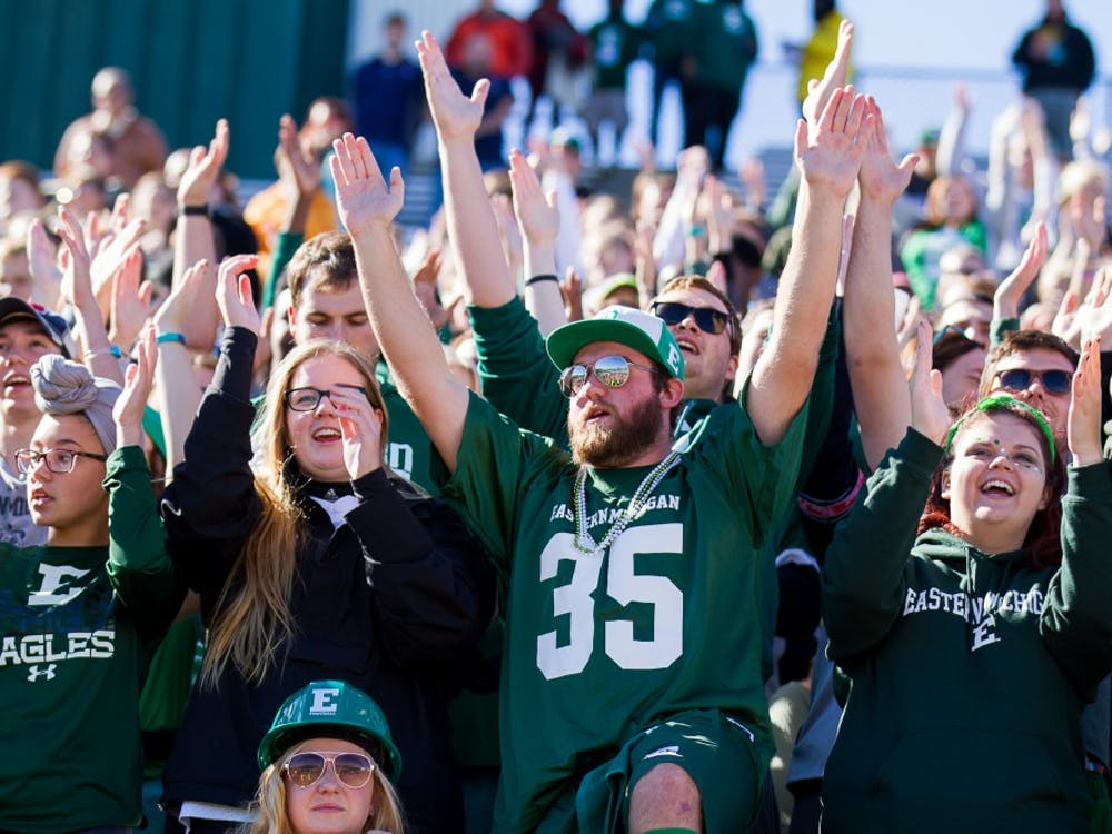 Students sing the fight song during the Eagles' loss to Toledo on October 8.