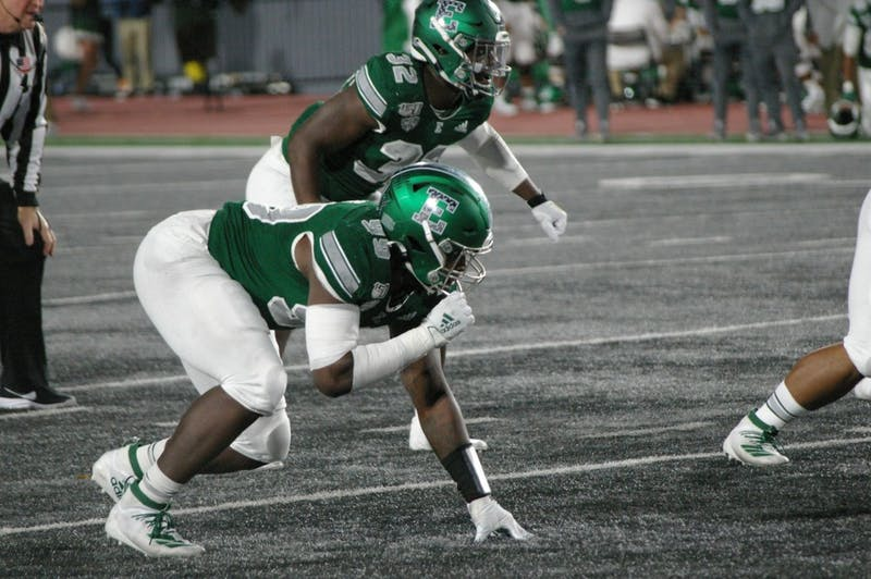 EMU defensive linemand sets for snap on Rynearson Stadium on Oct. 19.
