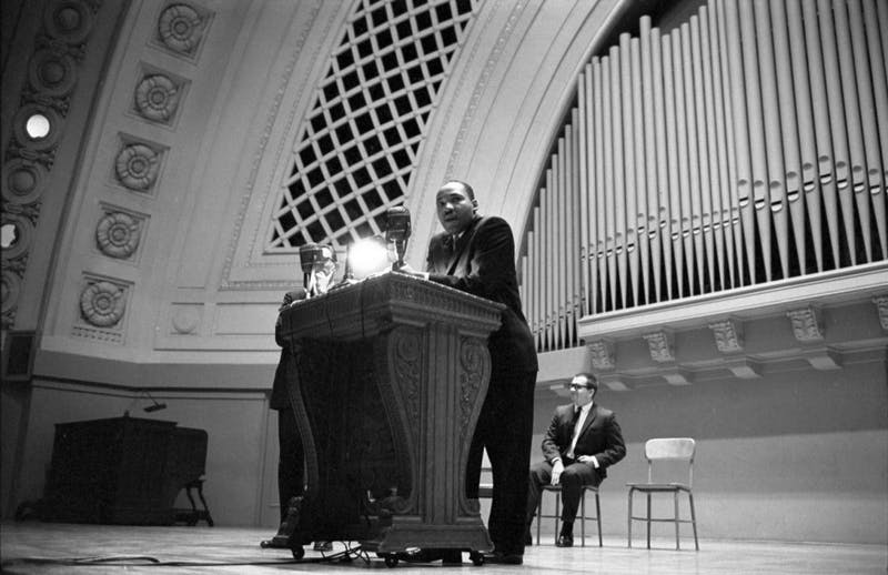Martin Luther King at podium, Hill Auditorium, November 11, 1962. Accessed from University of Michigan Bentley Historical Library.