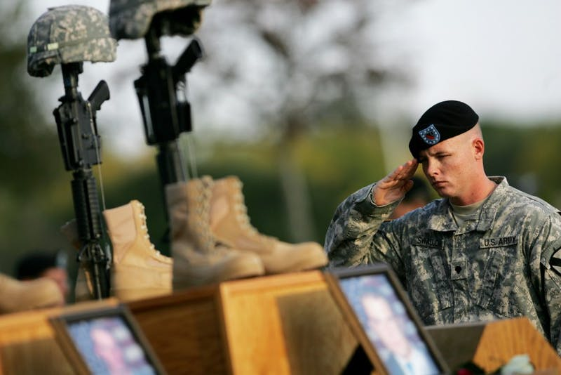 A soldier salutes during a memorial service for the victims of the Fort Hood shootings in Killeen, Texas, Tuesday, November 10, 2009. (Courtney Perry/Dallas Morning News/MCT)