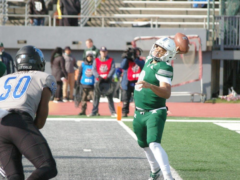 EMU quarterback Mike Glass III passes to his left at Rynearson Stadium on Nov. 2.