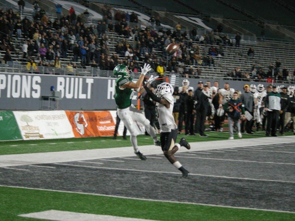 EMU receiver Mathew Sexton jumps up for touchdown at Rynearson Stadium on Oct. 19.