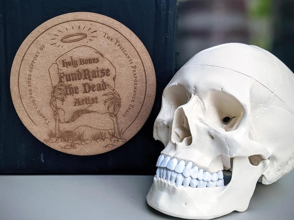 """The """"Fundraise the Dead"""" logo pictured next a skull decoration from Holy Bones Festival 2019. (Photo courtesy of Holly Schoenfield)."""