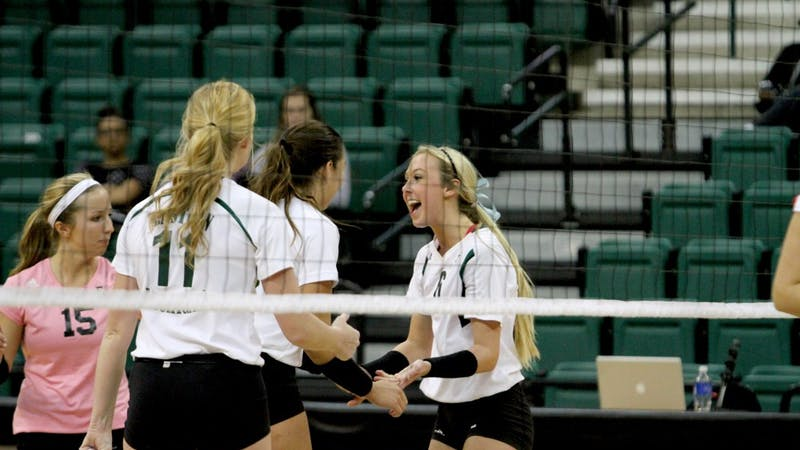 Jordan Smith celebrates a spike against Ball State at the Convocation Center.
